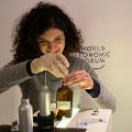 Ema at the World Economic Forum filling bottles with scented oils